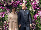 Former British prime minister Tony Blair and his wife Cherie pose during a photo opportunity at the wedding ceremony of Akash Ambani, son of the Chairman of Reliance Industries Mukesh Ambani at Bandra-Kurla Complex in Mumbai on March 9, 2019. Reuters