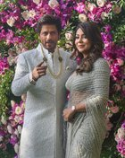 Bollywood actor Shahrukh Khan and his wife Gauri Khan pose for photos as they arrive for the wedding ceremony of Akash Ambani, son of the Chairman of Reliance Industries Mukesh Ambani at Bandra-Kurla Complex in Mumbai on March 9, 2019. PTI