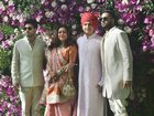 ADAG Chairman Anil Ambani, wife Tina Ambani, sons Jai Anshul Ambani and Jai Anmol Ambani pose for photos as they arrive for the wedding ceremony of Akash Ambani with Shloka Mehta in Mumbai on March 9, 2019. PTI photo