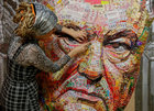 Ukrainian artist Dariya Marchenko works on a portrait of Ukraines President Petro Poroshenko named 'The Face of Corruption' which is made of wrappers from more than 20 kilograms of Roshen candies and empty shell cartridges brought from the frontline of a military conflict in the east of the country, in Kiev, Ukraine March 27, 2019. — Reuters