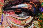 A partial view of the large-scale artwork entitled 'The Face of Corruption' created by Ukrainian artist Daria Marchenko and depicting the President Petro Poroshenko made with sweet wrappers of Roshen, shows an eye of the President in Kiev, Ukraine March 27, 2019.— AFP