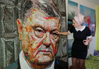 Ukrainian artist Dariya Marchenko shows pieces of a portrait of Ukraines President Petro Poroshenko named 'The Face of Corruption' which is made of wrappers in Kiev, Ukraine March 27, 2019. — Reuters