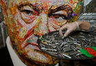 Ukrainian artist Dariya Marchenko works on a portrait of Ukraines President Petro Poroshenko named 'The Face of Corruption' which is made of wrappers and empty shell cartridges brought from the frontline of a military conflict in the east of the country, in Kiev, Ukraine March 27, 2019. — Reuters