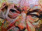 Ukrainian artist Daria Marchenko creates a large-scale artwork entitled 'The Face of Corruption' depicting the President Petro Poroshenko made with sweet wrappers of Roshen in Kiev, Ukraine March 27, 2019.— AFP