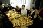 Guests attend a golden dinner with decadent 24 carat gold-covered dishes, a performance meal curated by artist and performer Frederique Lecerf in Paris, France, March 28, 2019. — Reuters