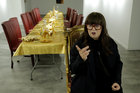 Artist and performer Frederique Lecerf speaks during an interview with Reuters as she prepares her performance meal for guests, a golden dinner with decadent 24 carat gold-covered dishes, in Paris, France, March 28, 2019. — Reuters