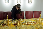 Artist and performer Frederique Lecerf prepares her performance meal for guests, a golden dinner with decadent 24 carat gold-covered dishes, in Paris, France, March 28, 2019. — Reuters