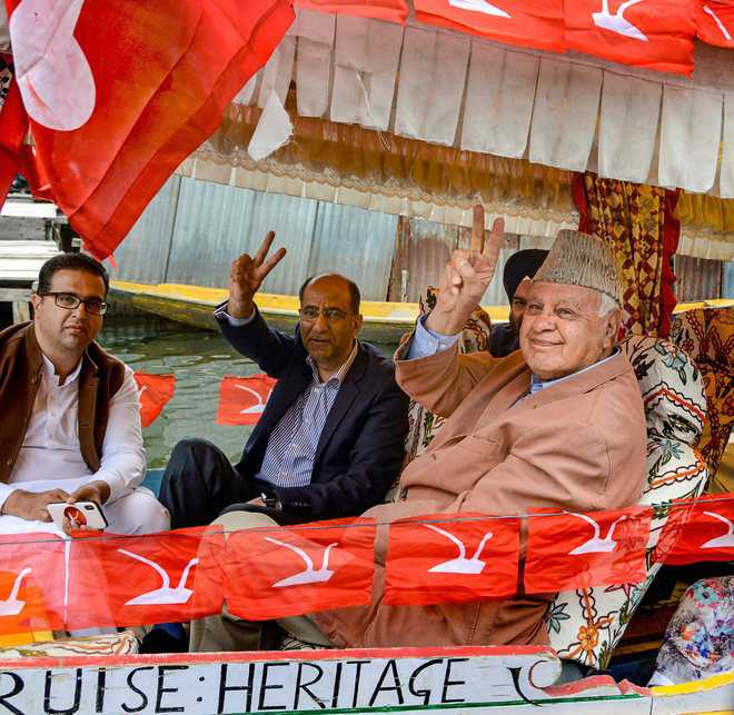 Farooq holds boat rally at Dal Lake in Srinagar