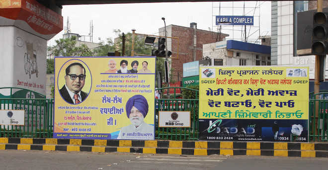 Violation of poll code continues as hoardings still dot city areas