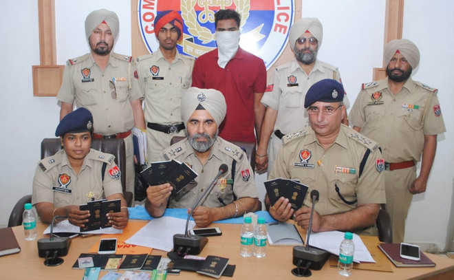 Impersonating as travel agent, cops held for fraud