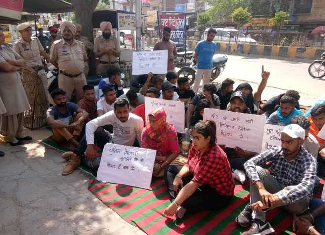 Village youths protest outside police station