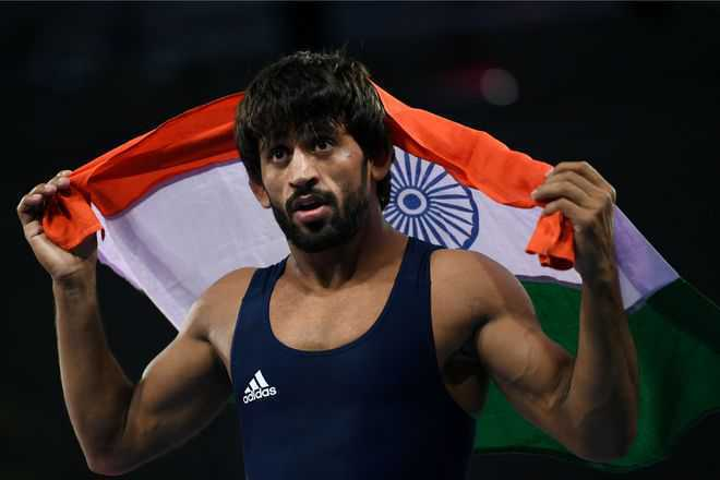 Bajrang reclaims gold at Asian Wrestling C'ship with tough win in final