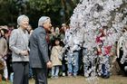 Japans Emperor Akihito (R) and Empress Michiko (L) look at cherry blossoms at Kyoto Gyoen in National Garden, Kyoto, March 27, 2019. — AFP