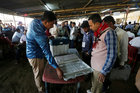 Polling officers check an (EVM) after collecting it from a distribution centre ahead of the first phase of general elections in Majuli in Assam on April 10, 2019. — Reuters