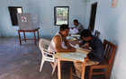 Polling officers sort out voter slips while setting up a polling booth ahead of the first phase of the general election in Majuli in Assam, on April 10, 2019. — Reuters