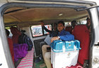 Officers sit in a vehicle as they leave for their assigned polling station after collecting the election materials from a distribution centre ahead of the first phase of general elections in Majuli in Assam on April 10, 2019. — Reuters