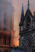 Flames and smoke are seen billowing from the roof at Notre-Dame Cathedral in Paris on April 15, 2019. — AFP