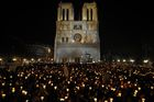 In this file photo taken on September 13, 2008 faithful hold candles during a 'Path of light' procession between Notre Dame Cathedral (background) and the Hotel des Invalides during the four-day visit in France of Pope Benedict XVI. — AFP