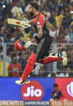 RCB survive Russell's charge