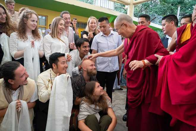 Now Dalai Lama to give group audience only