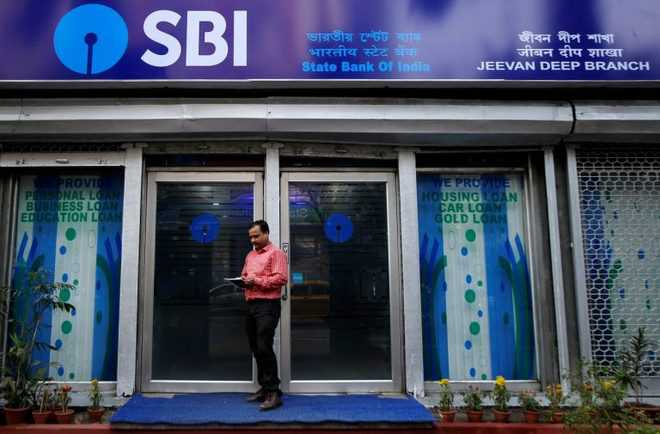SBI reports Rs 838-cr profit in Q4, trims bad loan ratio