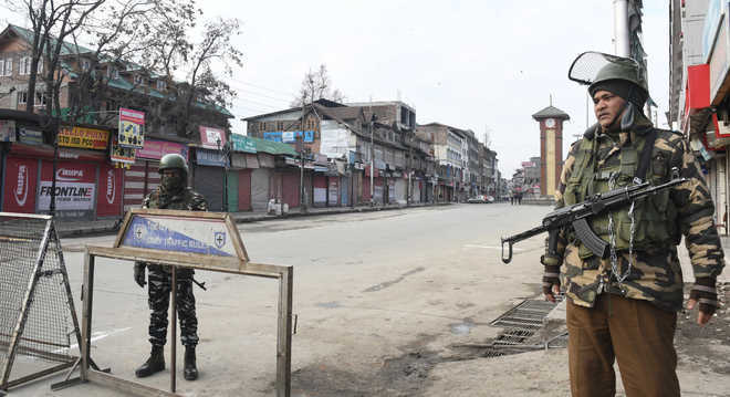 Curfew in parts of Kashmir following Tral encounter