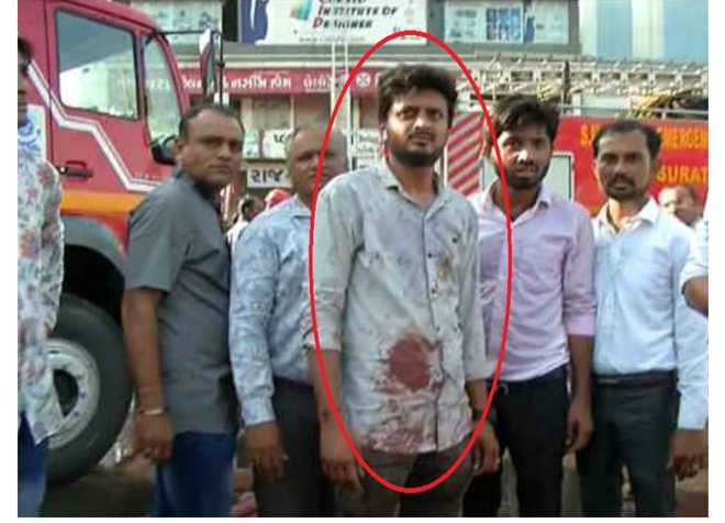 Surat tragedy: Youth endangers his life, saves two people
