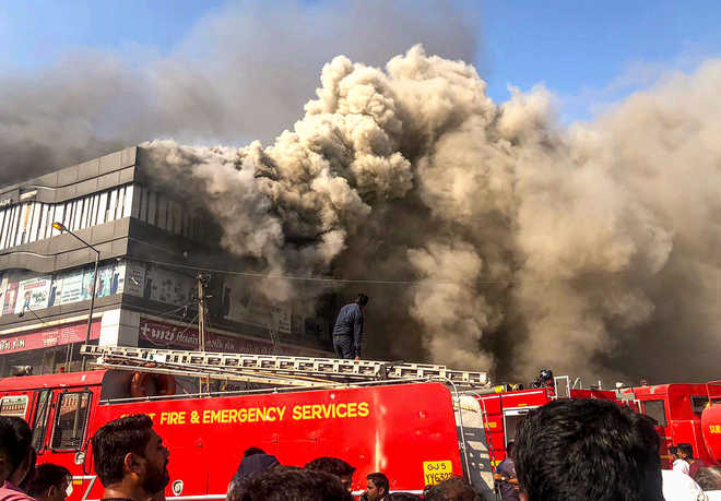 Surat tragedy: Coaching centre owner held; builders on the run