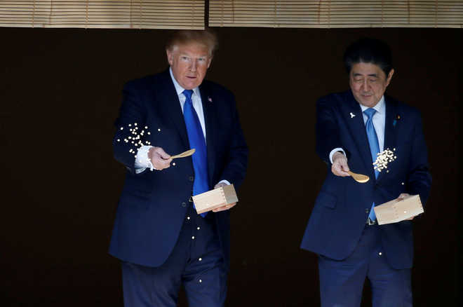 Donald Trump arrives for sumo summit with PM Shinzo Abe
