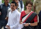 Indian political leader and National Congress general secretary for eastern Uttar Pradesh Priyanka Gandhi Vadra (R) and her husband Robert Vadra (L) look on as they arrive at a polling station in New Delhi on May 12, 2019. — AFP