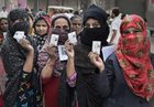 Women voters display their identity cards while waiting in a queue at a polling station during voting for the sixth phase of the 2019 Lok Sabha elections, in Khajuri area of east Delhi, Sunday, May 12, 2019. — PTI
