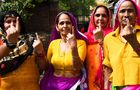 Indian women show their ink-marked finger after casting their vote at a polling station in Gurgaon, in the northern Indian state of Haryana on May 12, 2019, for the sixth phase of India's general election. — AFP