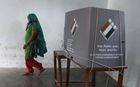 A women walks away after casting her vote at a polling station in Gurgaon in the northern Indian state of Haryana on May 12, 2019, in the sixth phase of the country's general election. — AFP
