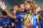 Mumbai Indians players Pandya brothers with Lasith Malinga celebrate with the IPL 2019 trophy after winning the final match against Chennai Super Kings, in Hyderabad, Monday, May 13, 2019.— PTI