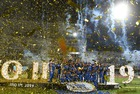 Mumbai Indians team players celebrate with the trophy after their victory against Chennai Super Kings in the 2019 IPLTwenty20 at the Rajiv Gandhi International Cricket Stadium in Hyderabad on May 13, 2019. — AFP