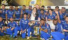 Mumbai Indians owner Nita Ambani along with players celebrate with the IPL 2019 trophy after winning the final match against Chennai Super Kings, in Hyderabad, Monday, May 13, 2019. — PTI