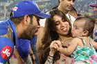 Mumbai Indians cricket team Captain Rohit Sharma with daughter Samaira after winning the 2019 IPL Twenty20 final cricket match at the Rajiv Gandhi International Cricket Stadium in Hyderabad on May 12, 2019. Photo credit: Twitter
