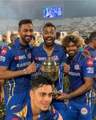 Mumbai Indians team players celebrate with the trophy after their victory against Chennai Super Kings in the 2019 IPLTwenty20 at the Rajiv Gandhi International Cricket Stadium in Hyderabad on May 13, 2019. Photo credit: Twitter