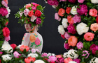 A model poses with body art and headwear made of Peonies at the RHS Chelsea Flower Show at the Royal Hospital Chelsea, London, Britain, on May 20, 2019. — Reuters