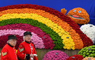 Two Chelsea Pensioners walk past a floral display based on children's television programs at the RHS Chelsea Flower Show at the Royal Hospital Chelsea, London, Britain, on May 20, 2019. — Reuters