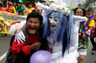 Clowns take part in a parade during Peru's Clown Day celebrations in Lima, Peru May 25, 2019. — Reuters