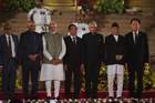 Newly sworn-in Prime Minister Narendra Modi (3L) poses for a picture with the President of India Ram Nath Kovind (2L) and regional leaders after taking the oath of office at the President house. — AFP