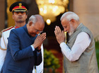 President Ram Nath Kovind greets Prime Minister Narendra Modi after he took oath of office and secrecy for the second consecutive term, at the forecourt of Rashtrapati Bhavan. — PTI