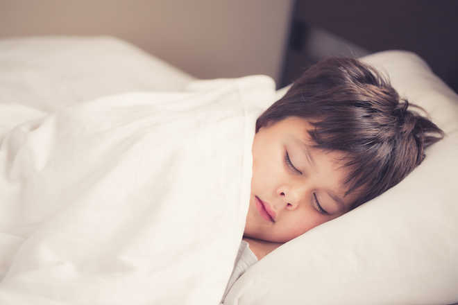 Afternoon naps can boost kid's happiness, IQ