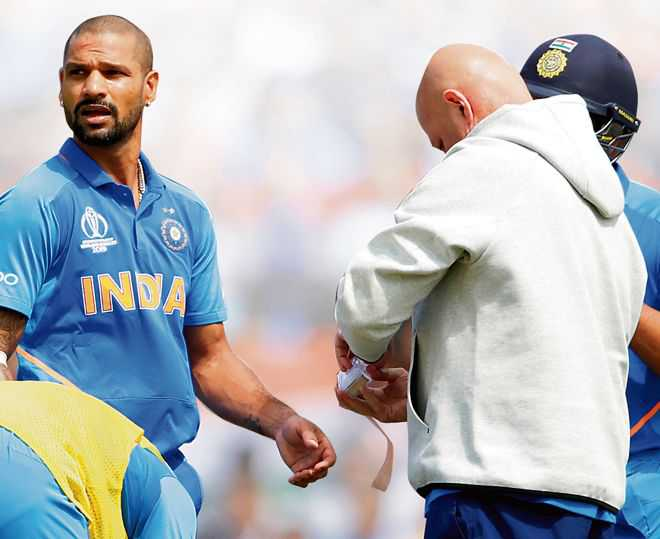 Dhawan injured, but will stay put with team