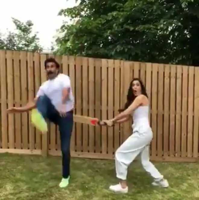 Deepika Padukone hits Ranveer Singh with a bat, says it is the story of his life 'reel and real'