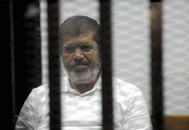 Egypt TV says ousted president Morsi dies in court
