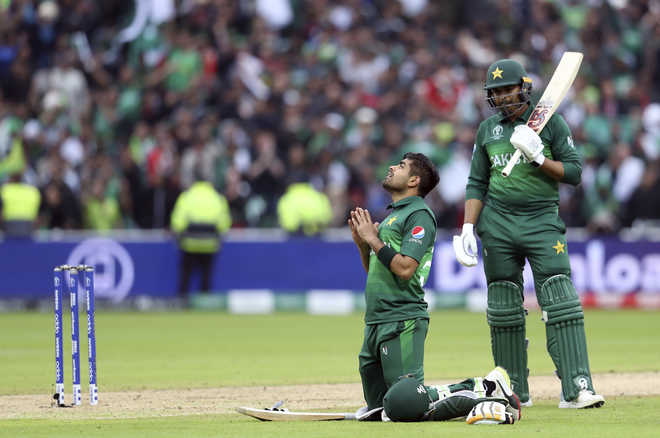 ICC World Cup: Azam's century guides Pakistan to 6-wicket win