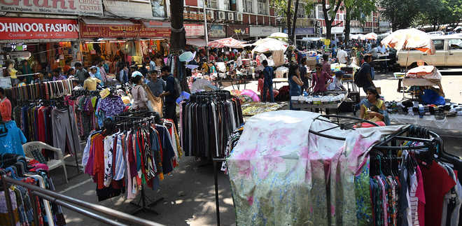 Pedestrians off road, vendors sit pretty in markets