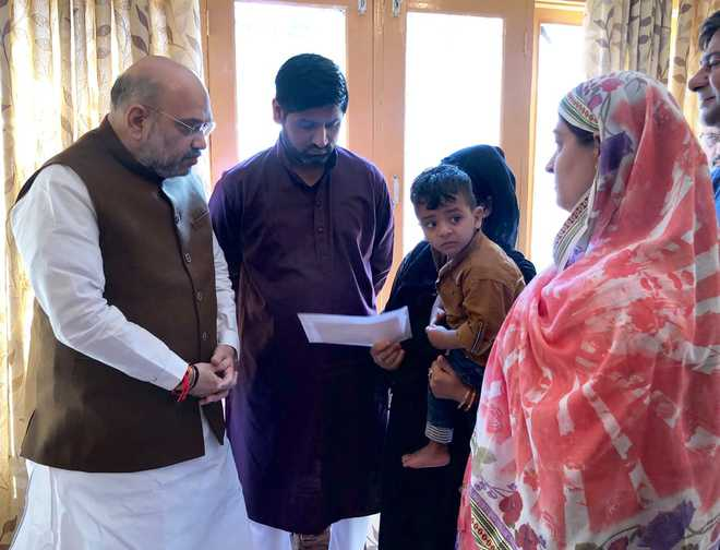 Nation is proud of your son, Shah tells family of slain J-K police officer